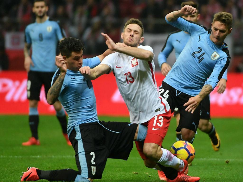 Polónia e Uruguai fazem experiências e esquecem golos